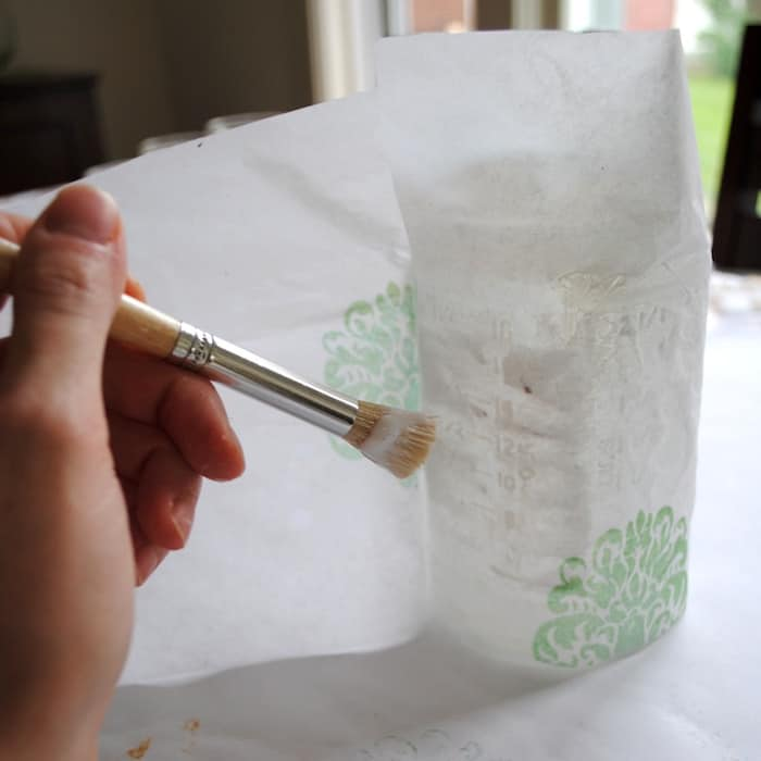 Make mason jar centerpieces out of recycled jars - using tissue paper and Mod Podge! Grab items from your stash to make this project completely free.