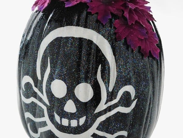 Sparkle up a skeleton pumpkin with Mod Podge