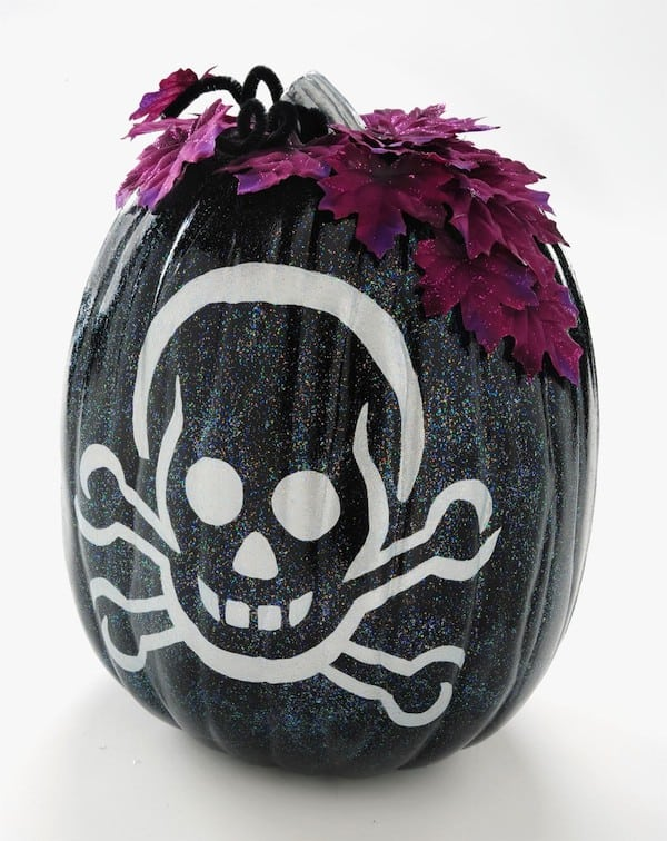 Make a painted pumpkin with a skeleton design. This Halloween craft is SO easy - add Sparkle Mod Podge for a really festive touch!