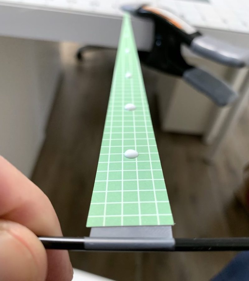 A paper triangle with dabs of glue