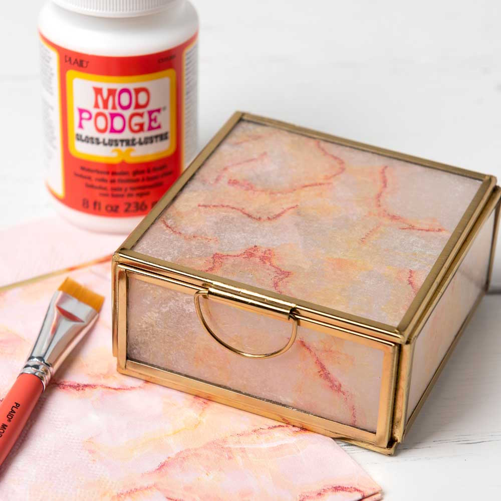 Decorate a glass jewelry box with napkins