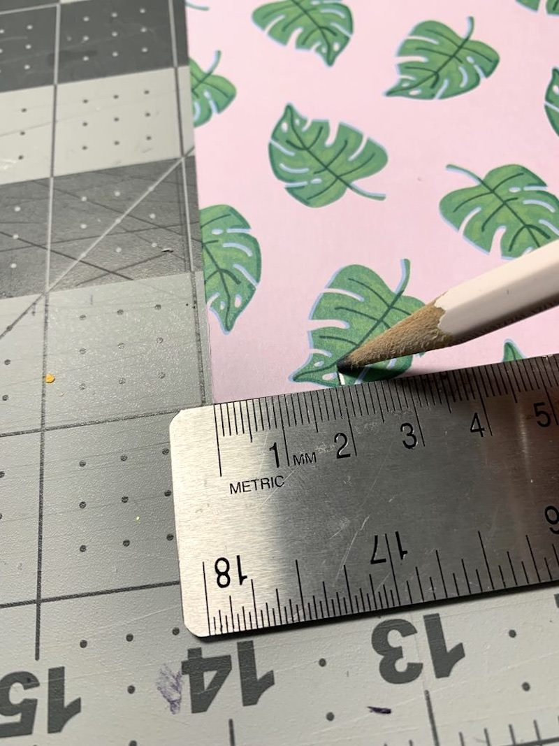 Measure and cut scrapbook paper