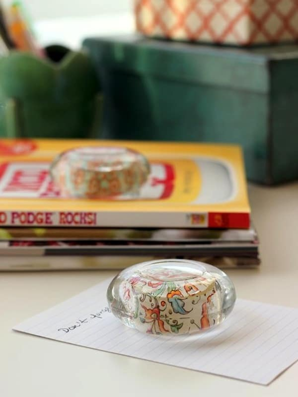 Create gorgeous, customizable DIY paperweights from dollar store glass candle holders! This easy project makes a great gift idea, and you can personalize!