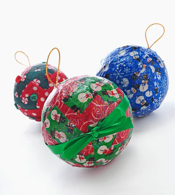 Are you looking for fun and easy kids Christmas crafts? Learn how to use Mod Podge to make pretty and sparkly decoupage ornaments!