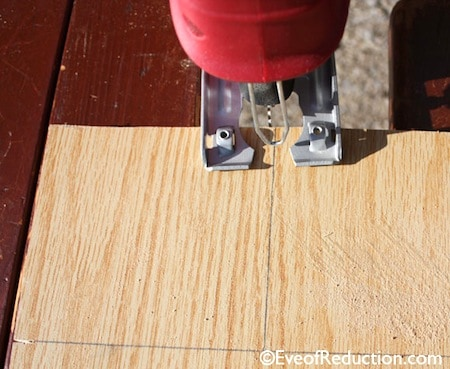 Cutting scrap plywood with a jigsaw to make candlestick holders