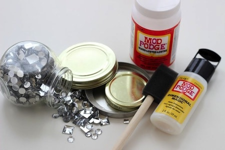 Supplies to make can lid ornaments