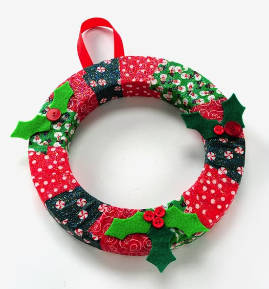 Looking for the perfect Christmas kids' craft to keep the little ones busy this holiday season? Try my Mod Podge DIY wreath, with just a few supplies!