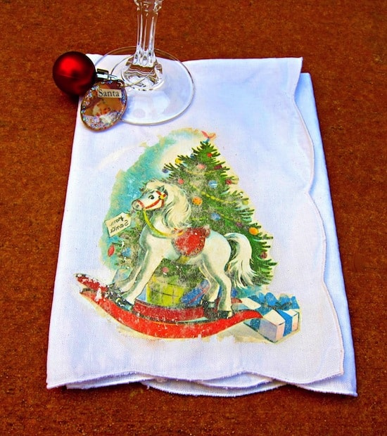 Use Mod Podge photo transfer medium to create these awesome Mod Podge photo transfer Christmas napkins - complete with a vintage holiday graphic!