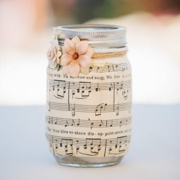 Maybe you need table decorations for a party or wedding on a budget? Mason jar centerpieces are a great idea - this one uses sheet music and Mod Podge.