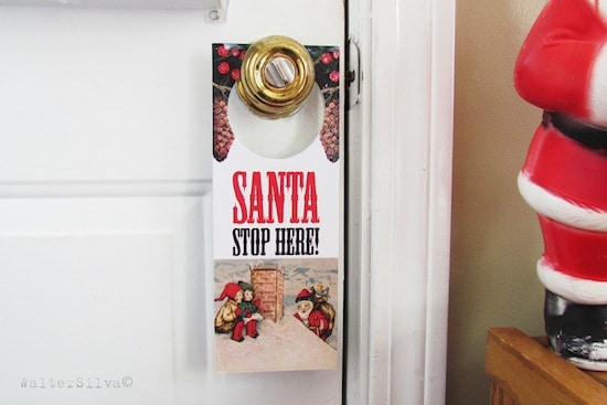 Make a Christmas door hanger that tells Santa to stop at your house using vintage graphics. Add special touches of Sparkle Mod Podge to make it pop!