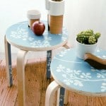 Perk up a plain table or stool with salvaged wallpaper scraps.