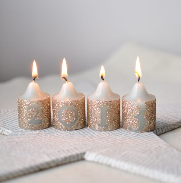 Decorate candles with glitter and Mod Podge