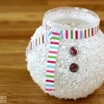 Celebrate winter indoors with this unique snowman craft - a small glass vase covered with epsom salts using your favorite decoupage medium.