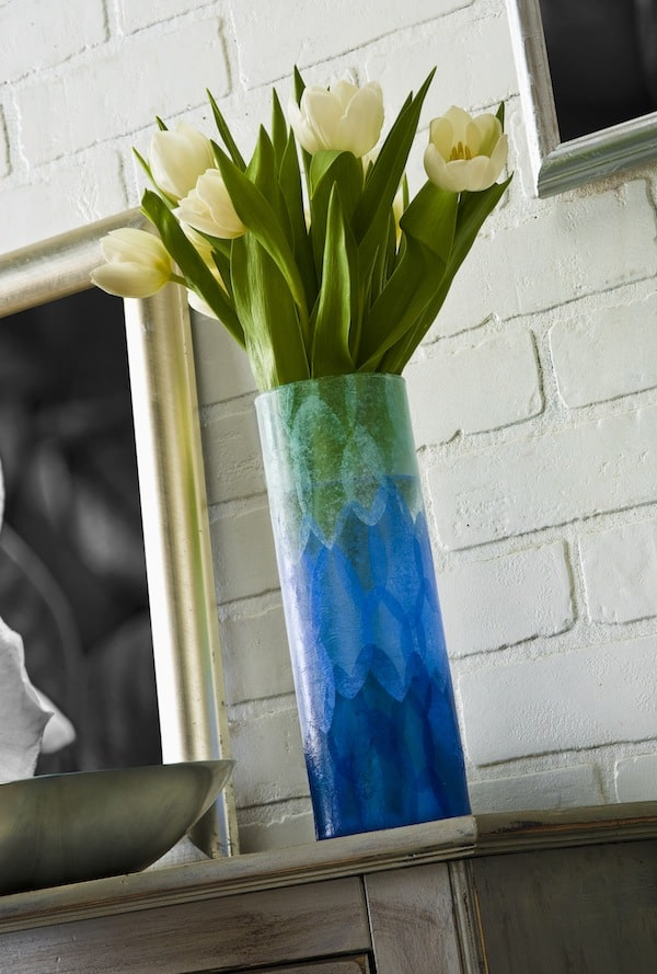 Learn how to decorate a vase with tissue paper and Mod Podge. Such an easy way to update a plain glass piece, and makes a great gift!
