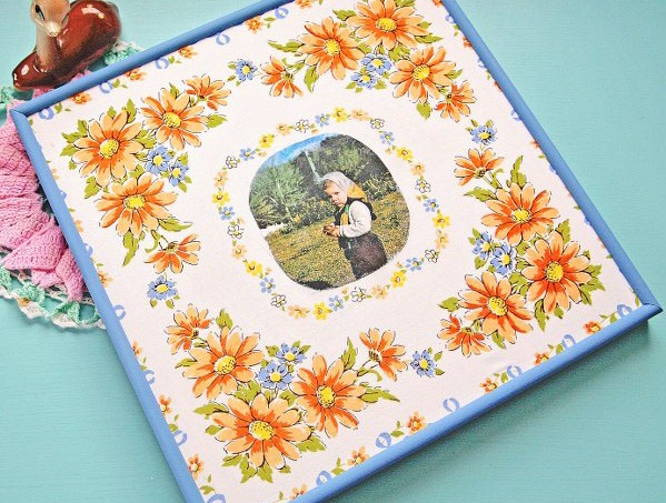 If you've never tried Mod Podge photo transfer medium, this is a fun project to start with. Turn an old frame into a new home decor piece with a hanky!