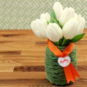 This St. Patrick's Day vase is the easiest thing you'll ever do! Bring a little luck into your home with Mod Podge and green yarn.