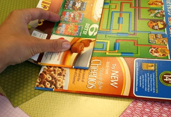 Cutting cereal boxes for a craft organizer