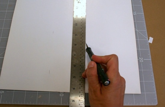 Measuring and cutting paper with an X-Acto knife