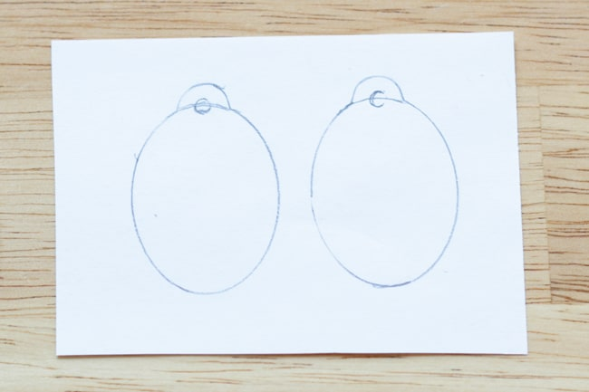 Earring shapes traced onto paper