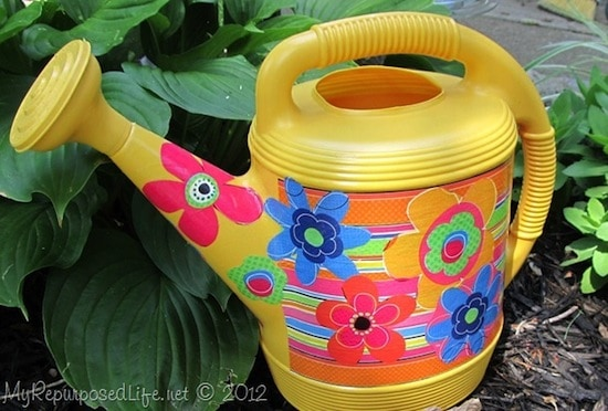 Decorate a watering can with fabric and Mod Podge