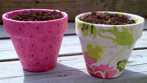 Use pretty fabric on these mod podge terra cotta pots for the perfect spring craft project
