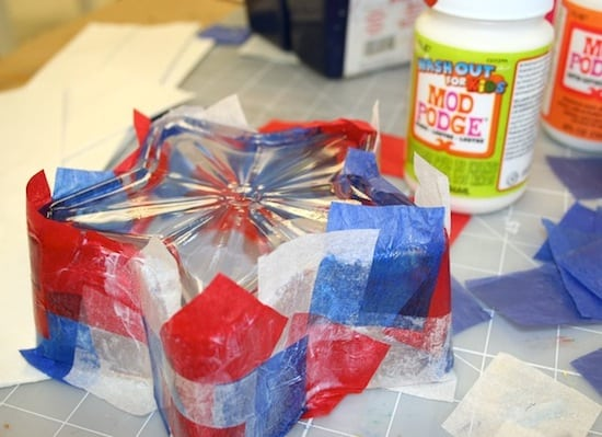 Applying red, white, and blue tissue paper to the star shaped glass dish