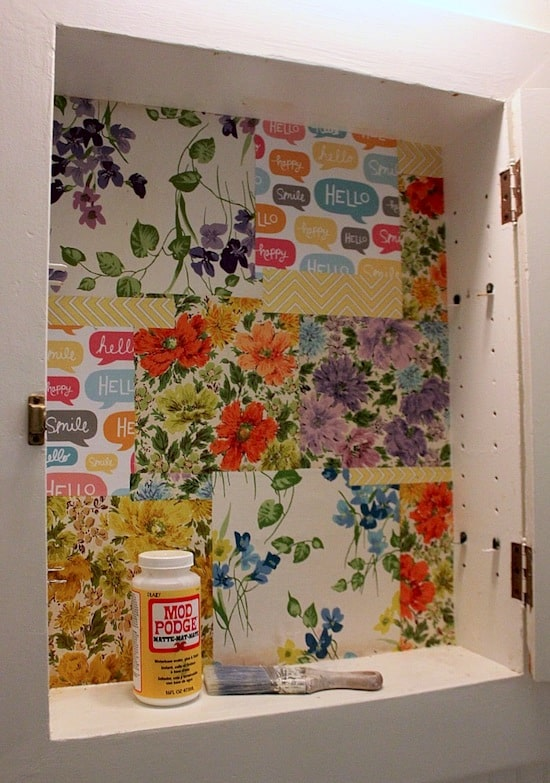 Mod Podge medicine cabinet redone with scrap paper