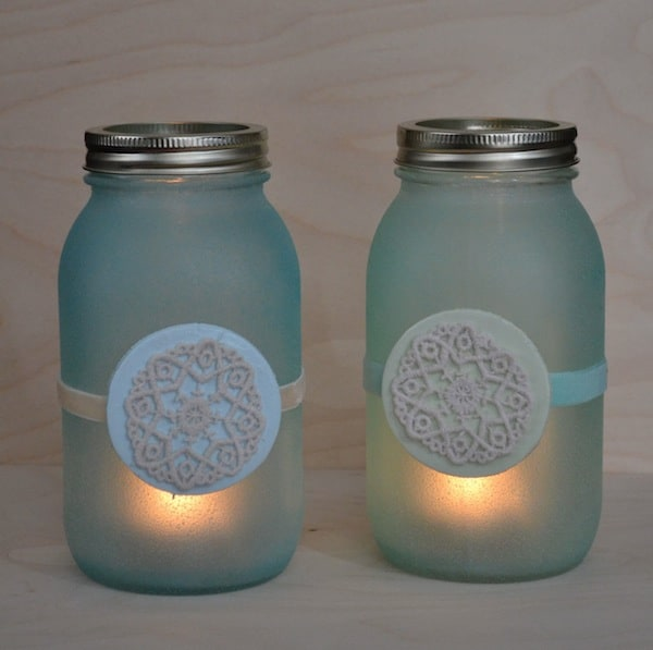 Use glass paint on mason jars to turn them into faux beach glass lanterns - then add Dimensional Magic wood circles on top for decoration.