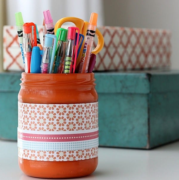 Take an old glass jar and turn it into a pencil holder with Mod Podge