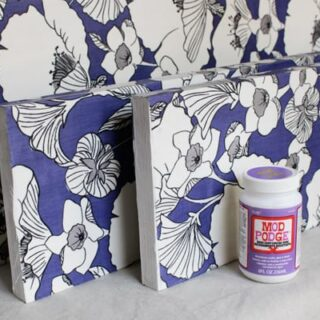 Give those boring shelves a complete makeover - decoupage fabric with Mod Podge Hard Coat - this is an easy and budget friendly project!