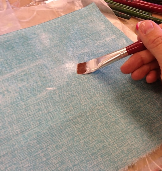 Adding Mod Podge to fabric with a paintbrush