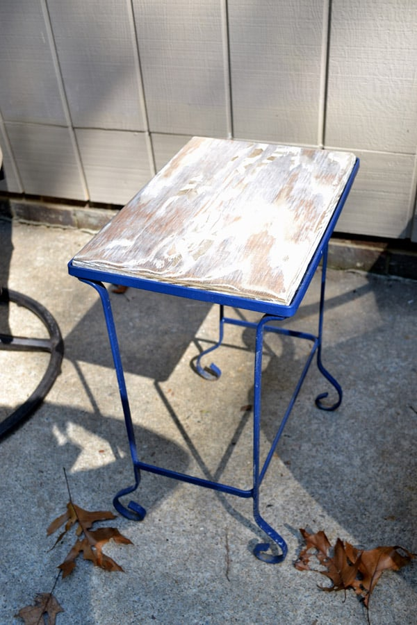 Spray painted iron table frame with wood