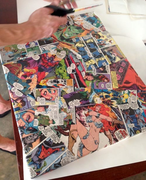 Canvas covered in comic book pages decoupaged down with Mod Podge