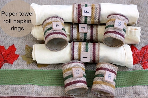 Use recycled paper towel rolls to make these burlap DIY napkin rings. You'd never guess they were made for pennies! Perfect for the holidays.