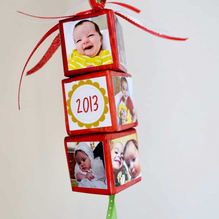 Create festive, personalized photo Christmas ornaments using your favorite pictures, wood blocks and Mod Podge. These make great gifts!