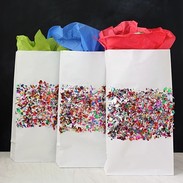 Create these unique gift bags with your favorite Mod Podge formula and sparkly confetti. This is perfect for gift wrapping on a budget!