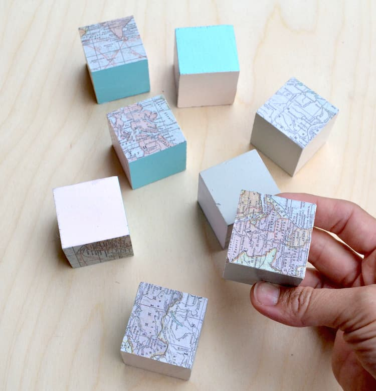 Do you love decoupaging with maps? These map blocks are such a fun Mod Podge project - perfect for a kids' room or bookshelf!