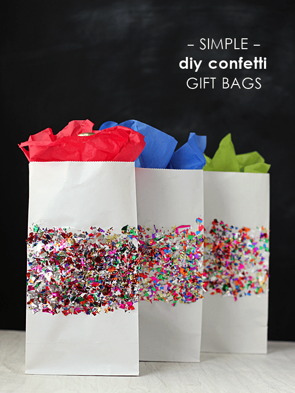 These DIY gift bags are so easy to make and I think are even cuter than store-bought options! I wish I could take credit for this idea, but I saw a video on Facebook around Christmas that I believe was posted by The Today Show (or another morning show--I can't remember which one it was) demonstrating how to make a gift bag from wrapping paper.