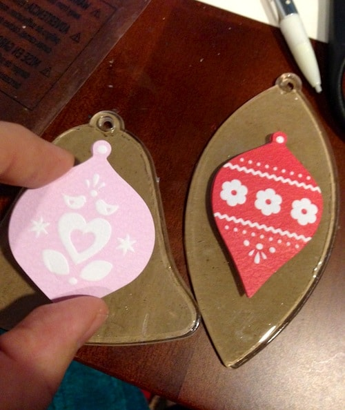 Placing stickers on top of the kraft paper ornament