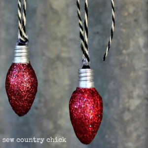 Don't throw away burned out night light bulbs - turn them into light bulb Christmas ornaments with Mod Podge and glitter!