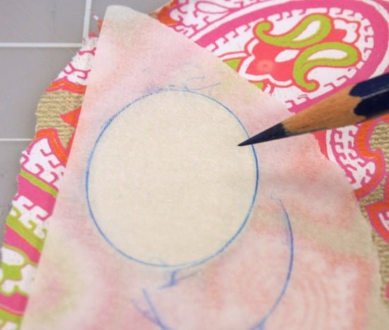 Trace a metal blank with tracing paper and a pencil