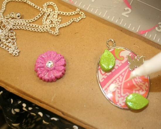 Glue embellishments to the DIY necklace
