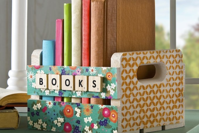 Use Mod Podge stencils and sand to decorate a wood crate - perfect for holding books, craft supplies or anything else you need to store.