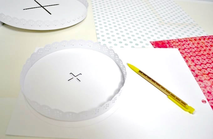 trace a cake stand on a piece of paper with a pencil