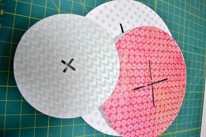 scrapbook paper on a cake stand