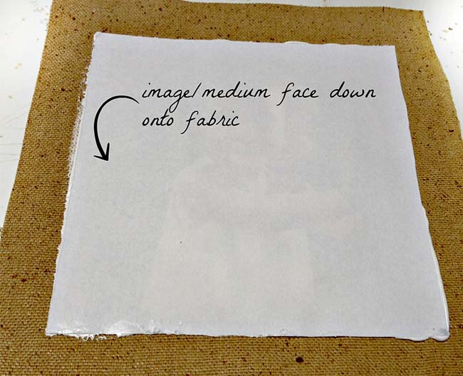 Image and medium face down on fabric