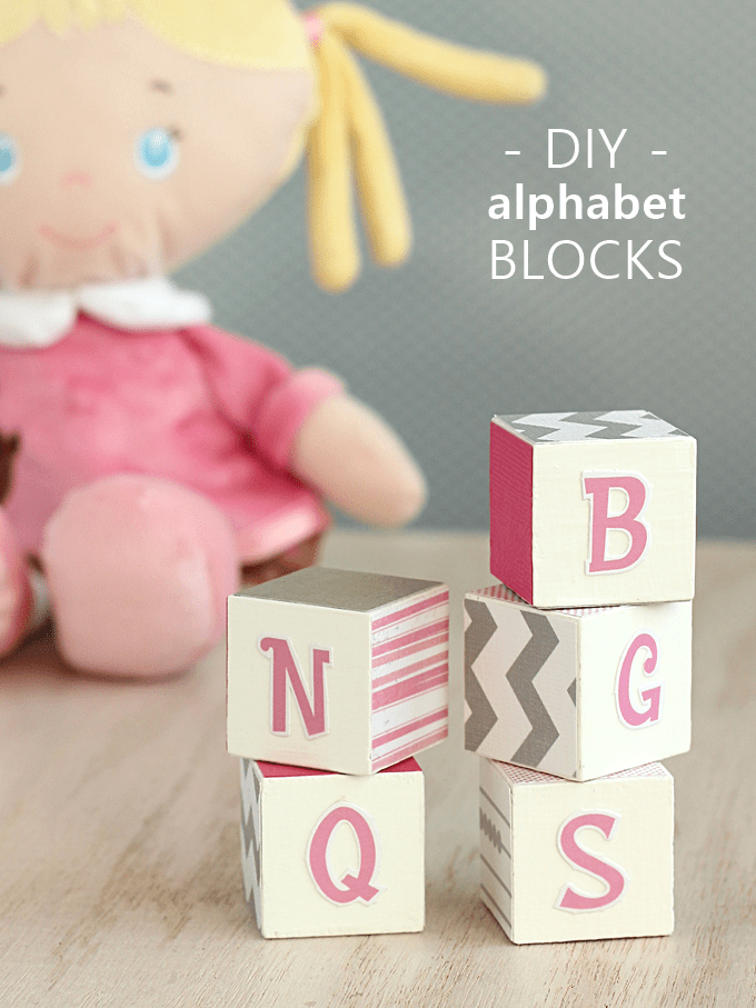 Make cute DIY alphabet blocks for nursery or room decor! This easy decoupage craft is perfect for a beginner to tackle and is so cute.
