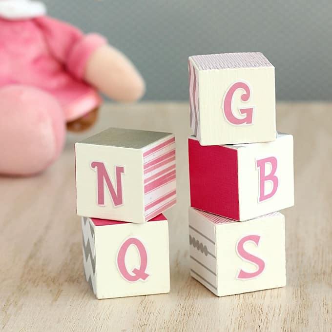 Make cute DIY alphabet blocks with your kids! This easy decoupage craft is perfect for a beginner to tackle.