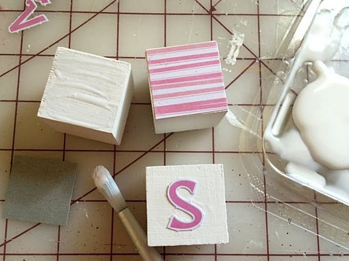 Making DIY wooden abc blocks with Mod Podge and scrapbook paper