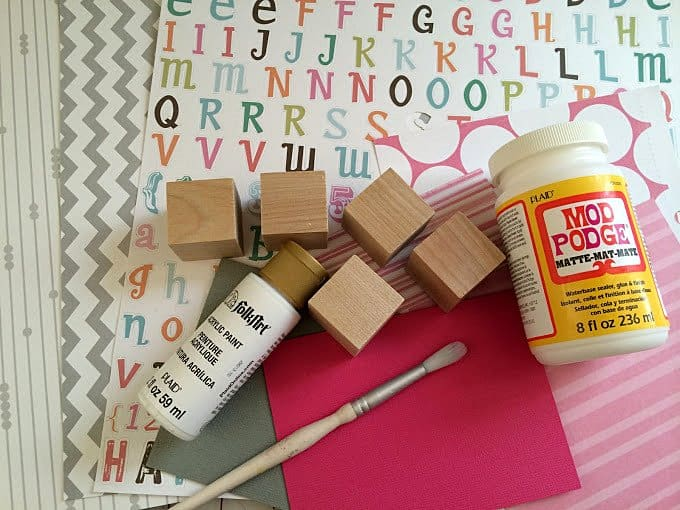 Wood blocks, Mod Podge Matte, white craft paint, paper, stickers, and a paintbrush